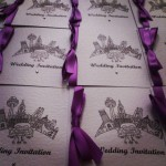 Personalised Liverpool themed invites with purple ribbon